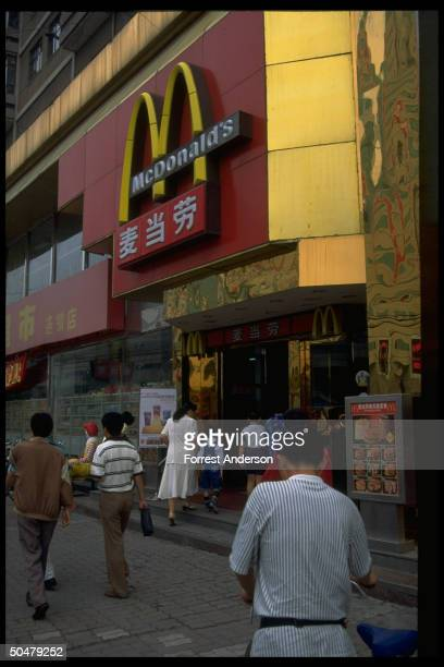 Locals entering McDonalds outlet of USbased fast food chain mark of growing Amer influence on Chinese culture