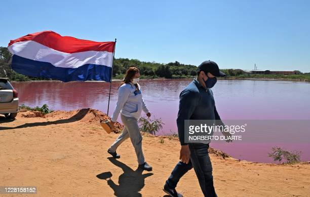 Locals gather at the shore of the Cerro Lake, formed from a meander of the Paraguay River, to protest against a nearby tannery which allegedly throws...