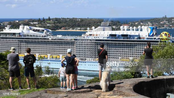Locals gather to watch on a headland as Royal Caribbean's cruise ship Spectrum of the Seas is escorted by Australian Border Vessels and Maritime...