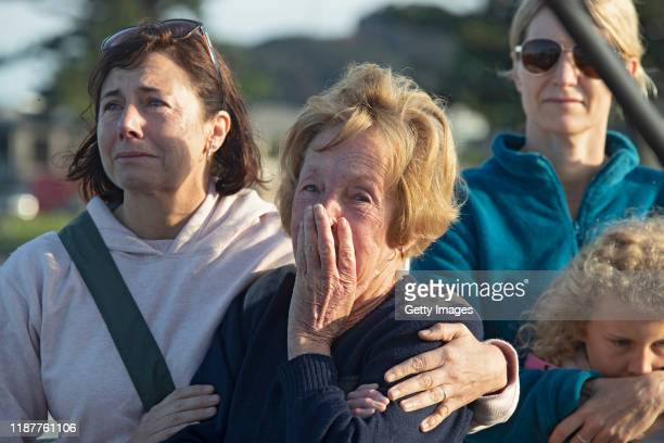 Locals gather to wave off the Ovation of the Seas cruise ship which carried passengers who travelled to White Island when it erupted in the Port of...