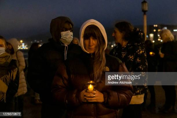 Locals gathered on Dover seafront for a candlelit vigil to mark the tragic death of the Kurdish-Iranian family who lost their lives attempting to...