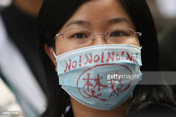 Locals hold a banner reading oppose garbage incineration protect green Guangzhou as they protest outside government offices in Guangzhou Guangdong...