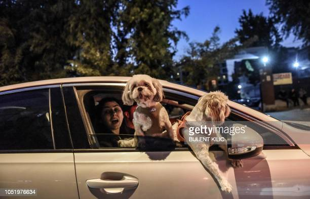 Locals in a car watch the house of US pastor Andrew Craig Brunson house in Izmir on October 12 2018 as he arrived home after being freed following a...