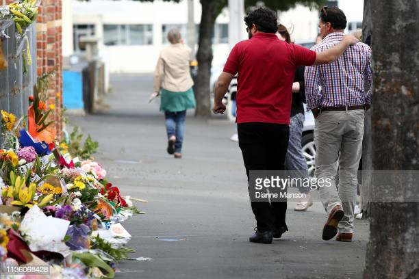 Locals lay flowers at the Huda Mosque in tribute to those killed and injured at the Al Huda Mosque on March 16 2019 in Dunedin At least 49 people are...
