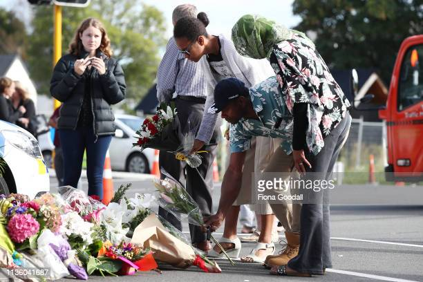 Locals lay flowers in tribute to those killed and injured at Deans Avenue near the Al Noor Mosque on March 16 2019 in Christchurch New Zealand At...