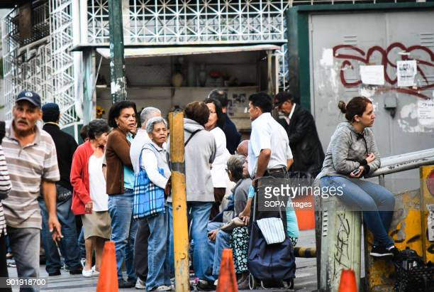 Locals lineup to purchase their food supply outside one of the stores that remains open The government of President Nicolas Maduro ordered to...