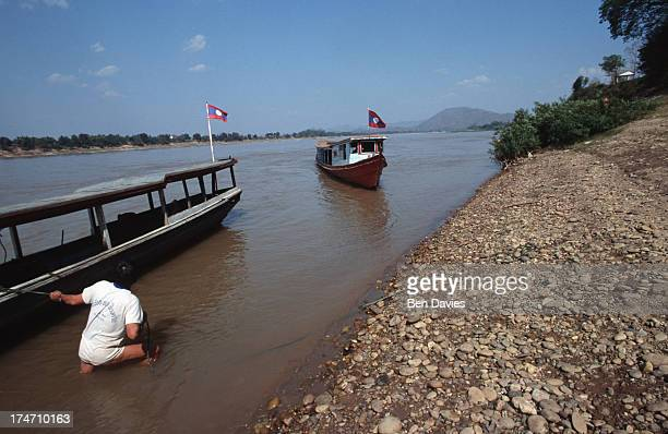 Locals load up a cargo boat on the Mekong River near the picturesque village of Chiang Khan in Loei Province From this border crossing boats sail...