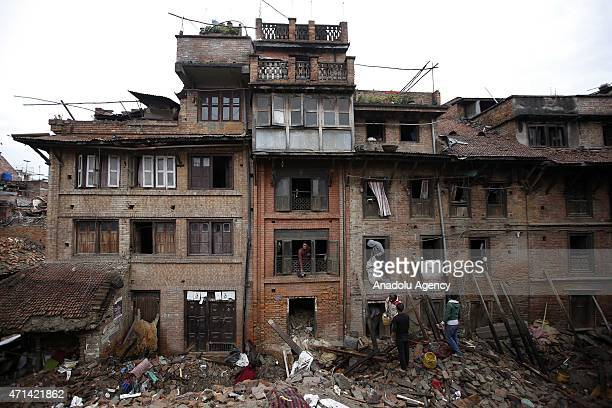 Locals look for belongings among the rubble of the damaged buildings in Bhaktapur, Nepal on April 28, 2015. The death toll in Nepal following the...