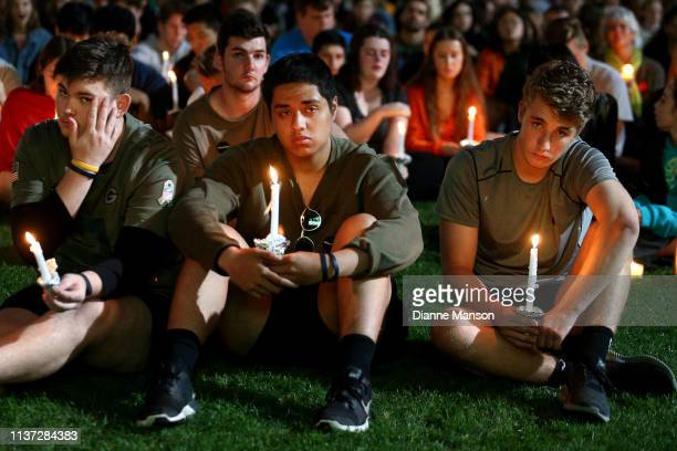 Locals look on during the vigil held at Forsyth Barr Stadium on March 21 2019 in Dunedin New Zealand 50 people were killed and dozens were injured in...