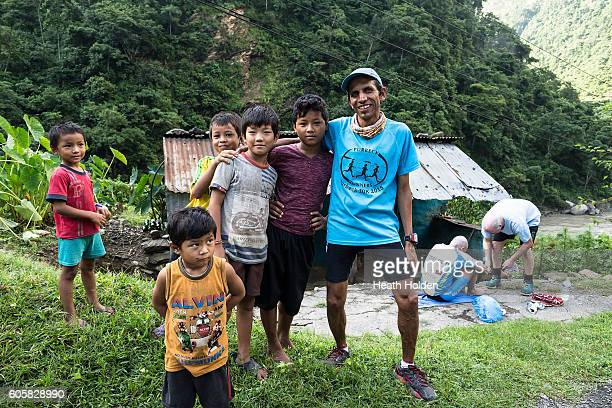 Locals meet Tim Blair and crew when they stop for some stretching at a small roadside villages on September 15 2016 near Bandipur Nepal Set up by...
