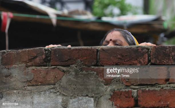 Locals of Sushilpura slum and police officials await BJP National President Amit Shah's arrival for lunch at a dalit's home on the concluding day of...