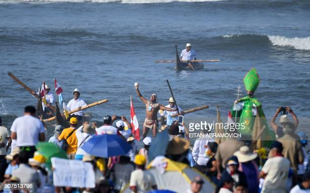 Locals perform a traditional indigenous welcome ceremony at the beach resort town of Huanchaco northwest of the Peruvian city of Trujillo prior to...