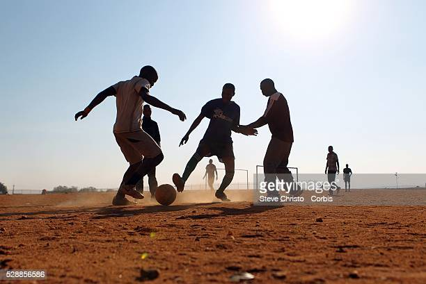 Locals play a morning game of soccer on a dirt pitch in Alexandra Township in Johannesburg South Africa during the 2010 World Cup