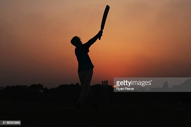 Locals play cricket on the Maidan at sunset ahead of the ICC World Twenty20 India Final between England and West Indies at Eden Gardens on April 2...