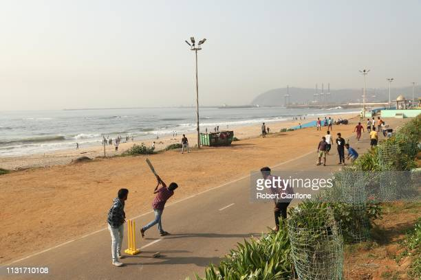 Locals play cricket on Varun beach ahead of game one in the T20I Series between India and Australia on February 24, 2019 in Visakhapatnam, India.
