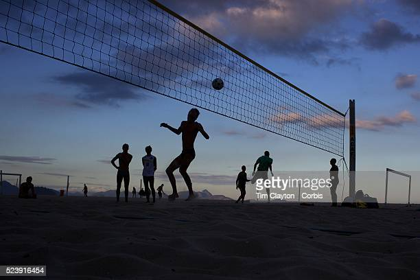 Locals play foot volley a hybrid game combining beach volley ball and football at Copacabana beach Rio de Janeiro Brazil 5th July 2010 Photo Tim...