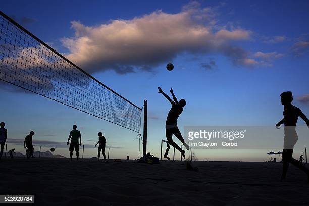 Locals play foot volley a hybrid game combining beach volley ball and football at Copacabana beach Rio de Janeiro Brazil 5th July 2010