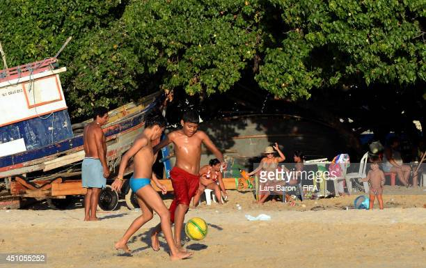 Locals play football at the Iracemar beach on June 22 2014 in Fortaleza Brazil