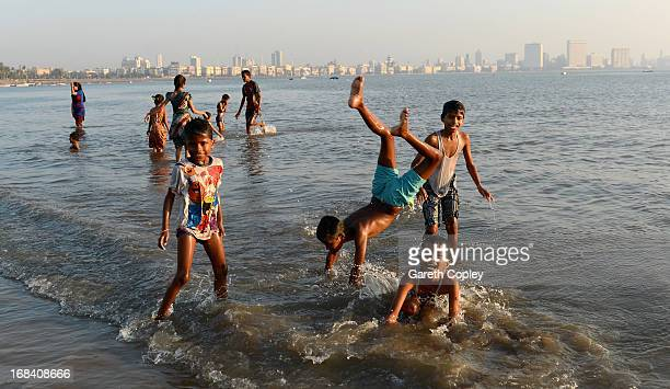 Locals play in the sea at Chowpatty Beach on November 23 2012 in Mumbai India