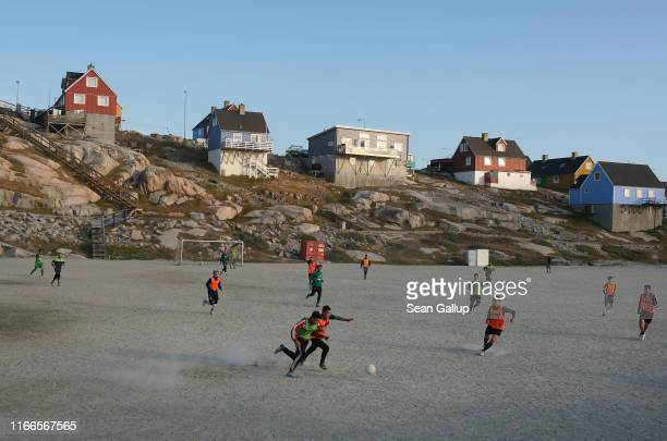 Locals play soccer on a Saturday on August 03, 2019 in Ilulissat, Greenland. As the Earth's climate warms summers have become longer in Ilulissat,...