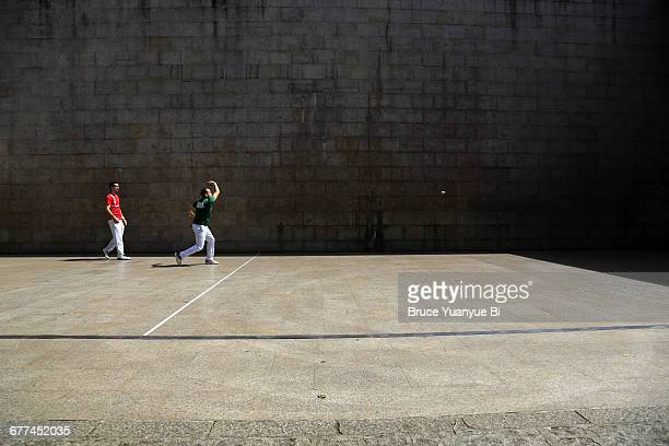 Locals playing Basque Pelota on street court