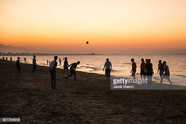 Locals playing football on beach in Muscat, Oman.