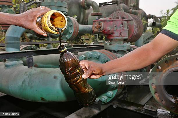 Locals pour containers of oil collected from an abandoned oil flow station operated by Royal Dutch Shell Plc in KDare Nigeria on Wednesday Jan 13...