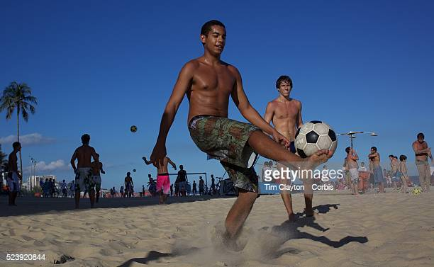 Locals practice foot volley a hybrid game combining beach volley ball and football at Ipanema beach Rio de Janeiro Brazil 4th July 2010 Photo Tim...