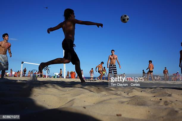 Locals practice foot volley a hybrid game combining beach volley ball and football at Ipanema beach Rio de Janeiro Brazil 5th July 2010 Photo Tim...