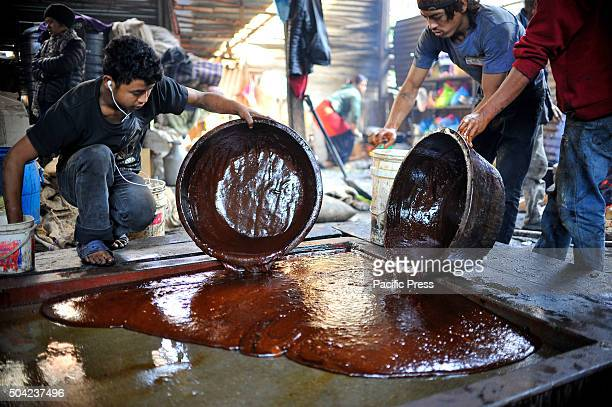 Locals put the molten raw hardened molasses or Chaku in a molder to cool down for the celebration of Maghe Sankranti Festival on January 15 2015...