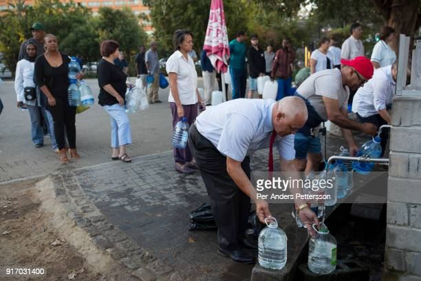 Locals queue for free water early in the morning from a well on February 7 2018 at SAB breweries in Newlands outside Cape Town South Africa The city...