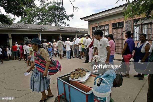 Locals queue to vote in Plan 3000 an outlying neighbourhood in Santa Cruz on December 6 2009 during presidential elections Bolivian President Evo...