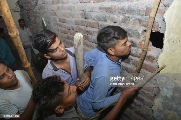 Locals searching for the leopard that sneaked in at Krishna Vihar Kuti locality near Delhi-Ghaziabad border on Thursday night on April 7, 2017 in...