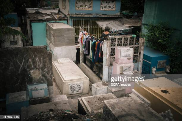 CEMETERY MANILA PHILIPPINES Locals seen hanging the washings at the graves to dry in the cemetery In the center of Pasay District of Metro Manila is...