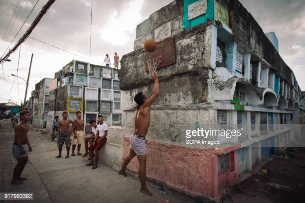 CEMETERY MANILA PHILIPPINES Locals seen playing basketball in a slum in a cemetery In the center of Pasay District of Metro Manila is a cemetery...