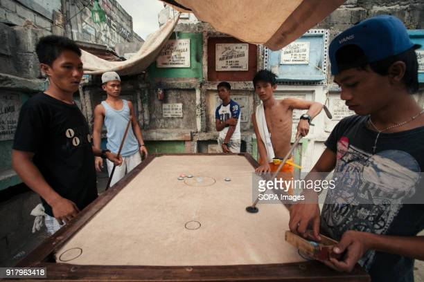CEMETERY MANILA PHILIPPINES Locals seen spending their afternoon in the slum in the cemetery In the center of Pasay District of Metro Manila is a...