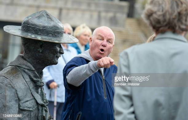 Locals shout their protest at Deputy Leader of Bournemouth Christchurch and Poole Council Mark Howell is interviewed at the Lord BadenPowell statue...
