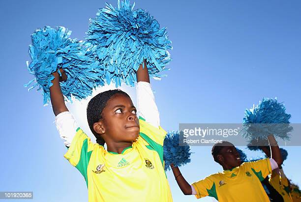 Locals sing and dance prior to a press conference to announce the Football Federation Australia will be donating lap desks to school children at...