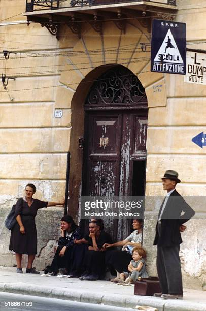 Locals sit in doorways 5 days after winning the campaign 'Operation Husky' in Palermo Sicily Italy
