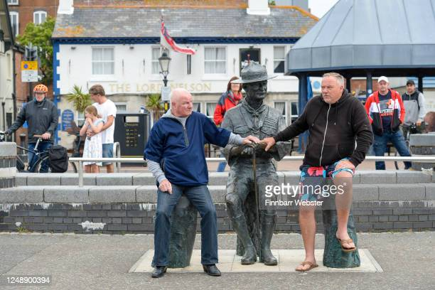 Locals sit to protest over the removal of the Lord BadenPowell statue on June 11 2020 in Poole United Kingdom The statue of Robert BadenPowell on...