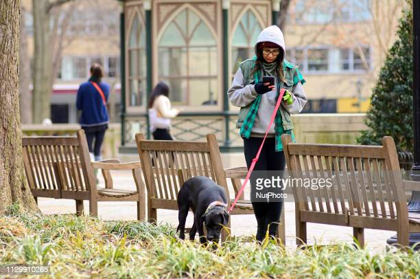 Locals stroll through Rittenhouse Square soon after the winter weather turns into more spring like conditions on March 11th in Center City...