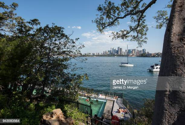 Locals swim and sunbathe in the Maccallum pool in Cremorne Point on April 9 2018 in Sydney Australia Sydney has been experiencing unseasonably high...