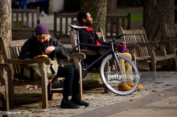 Locals take a break to enjoy the sun in Rittenhouse Square soon after the winter weather turns into more spring like conditions on March 11th in...