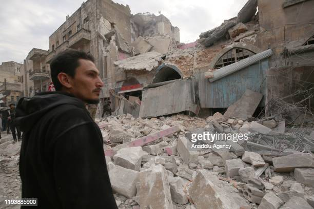 Locals view damaged buildings after airstrikes of the Assad regime and Russia hit a marketplace in Eriha district of Idlib, de-escalation zone, Syria...
