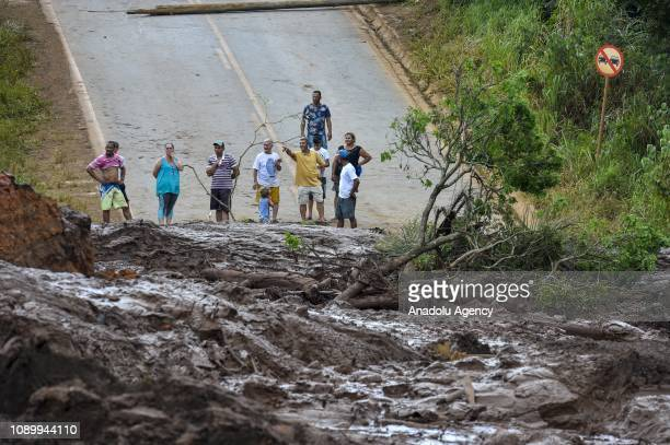 Locals wait at the scene after a tailings dam collapsed at an iron ore mine in Brumadinho state of Minas Gerias in southeastern Brazil on January 26...