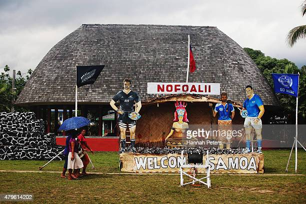Locals walk past hand made posters made for the arrival of the New Zealand All Blacks on July 6 2015 in Apia Samoa