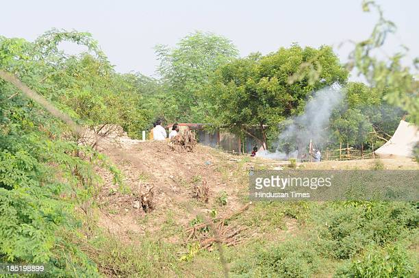 Locals watch as ASI and GSI officials began excavation work at the ruins of a 180yearold temple adjoining a fort belonging to erstwhile Bais Rajput...