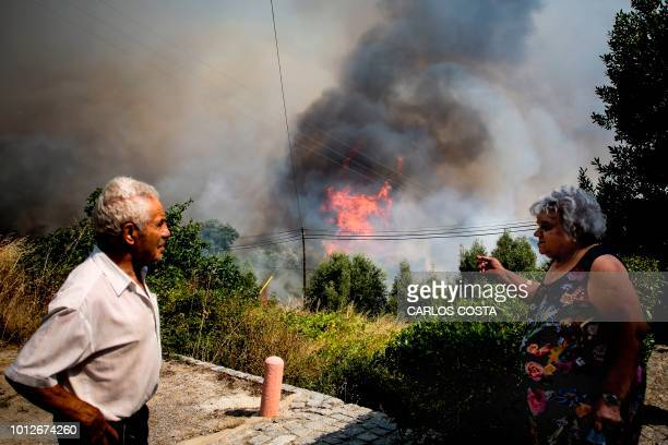 TOPSHOT Locals watch the progression of a wildfire close to Monchique in Algarve on August 7 2018 Hundreds of Portuguese firefighters and soldiers...