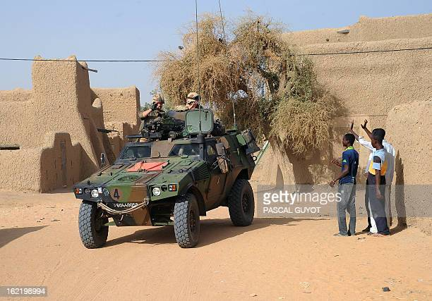 Locals welcome French soldiers in Bourem northen Mali on February 17 2013 A Frenchled military intervention launched on January 11 has driven the...