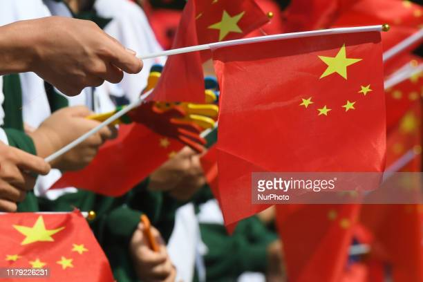 Locals with Chinese flags seen in the center of Qinzhou On Friday October 18 in Qinzhou Guangxi Region China